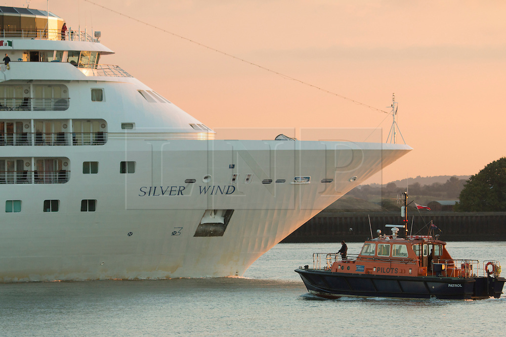 © Licensed to London News Pictures. 06/08/2016. A golden sunrise over the Thames at Gravesend this morning as the cruise ship Silver Cloud sailed down river from London at the beginning of a sunny August summer day. Credit : Rob Powell/LNP