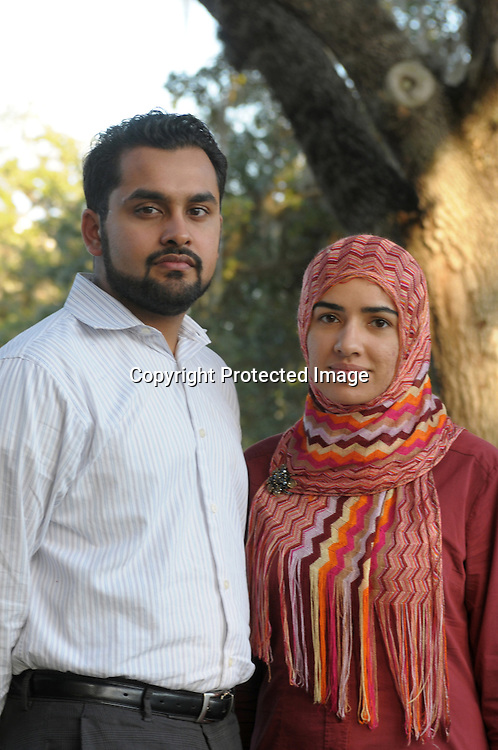 Atif Irfan, left, and his wife, Sobia Ijaz, stand outside the Regal Sun Resort in Lake Buena Vista, Fla., Friday, Jan. 2, 2009.  Both Irfan and Ijaz were not allowed to board an AirTran flight from Washington, D.C. to Orlando after passengers mistook a conversation their group had about the safest place to sit aboard their plane. (Photo by Phelan M. Ebenhack)
