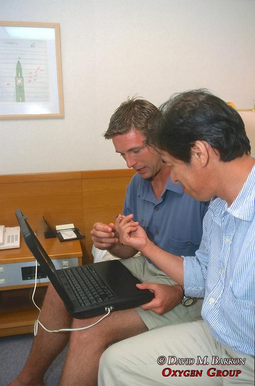 J. Nichols & Kazuyoshi Omuta Looking At Tag Found In Baja