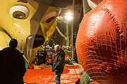 New York, NY – 27 November 2019. Thousands of spectators packed the streets around the American Museum of Natural History to see the inflation area for the balloons for Macy's Thanksgiving Day Parade. Workers are in front of the Chase balloon.