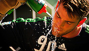 Portland Timbers goalkeeper JAKE GLEESON (90/green) cools off during a hot afternoon game with the Seattle Sounders Reserves. Portland took the win 3-2.
