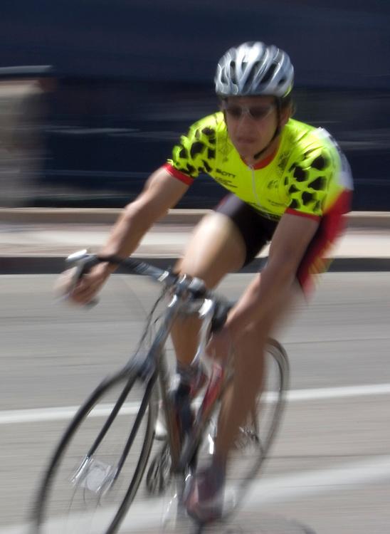 Blurry bicycle racer at 2009 UA Criterium on the University of Arizona campus. Bike-tography by Martha Retallick.