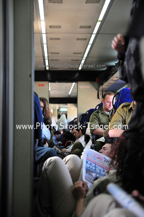 Israel, Interior of a train coach Soldiers on their way back to base after a weekend leave