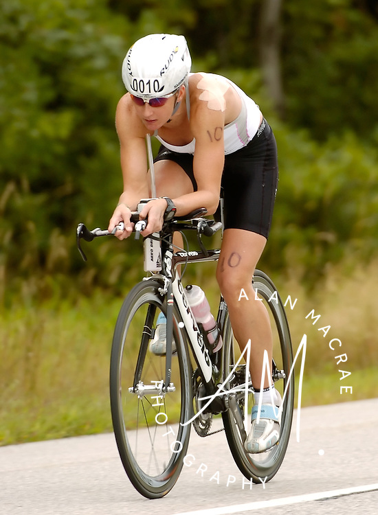 Tara Norton of Toronto, Canada closes in on the finish of the bicycle portion of Sunday's Timberman Triathlon.  (Alan MacRae/for the Citizen)