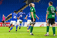 Cardiff City's Sean Morrison (4) turns away to celebrate with his team mates after scoring the match winning goal while Birmingham City's Marc Roberts (4) looks skyward during the EFL Sky Bet Championship match between Cardiff City and Birmingham City at the Cardiff City Stadium, Cardiff, Wales on 16 December 2020.