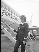 First Aer Lingus Female Pilot.    (M70)..1979..29.04.1979..04.29.1979..29th April 1979..Ms Grainne Cronin formerly a stewardess with Aer Lingus takes up her new role as the first female pilot with the airline. Ms Cronin from Ennis,Co Clare is the daughter of Aer Lingus Captain, Mr Phelim Cronin..After her walk around check of the aircraft, Ms Cronin is pictured as she prepares to ascend the stairway to her place in the cockpit...Note. Ms Cronin, in her career reached the rank of Captain in 1988. Her last flight saw her Captain an all female crew aboard an Airbus A330 on the Dublin / Boston route. She retired after 33 years of service.