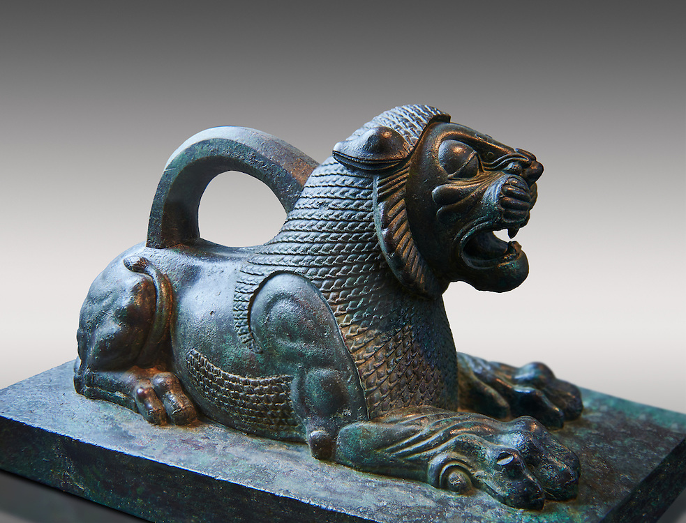 Bronze statuette of a Lion from the First Persian or Achaemenid Empire 6th to 5th cent. BC excavated from the Acropolis Susa, present day Iran.. The Louvre Museum, Paris. .<br /> <br /> If you prefer to buy from our ALAMY PHOTO LIBRARY  Collection visit : https://www.alamy.com/portfolio/paul-williams-funkystock/persian-antiquities.html  <br /> <br /> Visit our ANCIENT WORLD PHOTO COLLECTIONS for more photos to download or buy as wall art prints https://funkystock.photoshelter.com/gallery-collection/Ancient-World-Art-Antiquities-Historic-Sites-Pictures-Images-of/C00006u26yqSkDOM