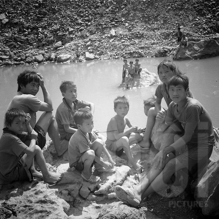 Kids hang out along a river,Ha Giang Province, Vietnam, Southeast Asia