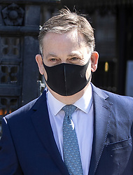 © Licensed to London News Pictures. 21/04/2020. London, UK. Nigel Adams MP, Minister of State, wears a protective face mask as he leaves The House of Commons. Parliament has re-opened today after the Easter holidays and the start of lockdown. The Speaker has asked MPs not to attend but to join in via Zoom where questions can be seen and heard on screens mounted in the chamber. Photo credit: Peter Macdiarmid/LNP