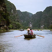 Rowing boat on Ngo Dong RIver in Northern Vietnam