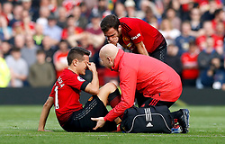 Manchester United's Ander Herrera (left) receives medical attention after picking up an injury during the Premier League match at Old Trafford, Manchester.