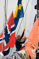 © Sander van der Borch.Alicante, 11 October 2008. Start of the Volvo Ocean Race.Magnus Olsson waving good by the crowd with a Swedish flag. The veteran, 59 years old, is sailing his 6th Volvo Ocean Race. .