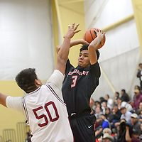 020615       Cayla Nimmo<br /> <br /> Crownpoint Eagle Kyle Henry (3) attempts to make a basket over the head of Rehoboth Lynx Jakob Yazzie (50) during the game held in Rehoboth Friday.