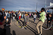 Host Wali Collins congratulates hula hoop competition winner Elena Valencia at the AARP Block Party at the Albuquerque International Balloon Fiesta in Albuquerque New Mexico USA on Oct. 7th, 2018.