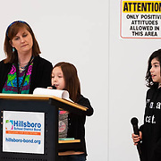Principal Lindsay Garcia looks on as Kiara Diaz makes comments during a ribbon cutting ceremony in the new gymnasium at Eastwood Elementary School in Hillsboro, Ore., on Tuesday, Feb. 4, 2020.