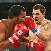 ORLANDO, FL - OCTOBER 04: Esquiva Falcao, 2012 Olympic silver medalist from Brazil (L), trades punches with Austin Marcum during a professional boxing match at the Bahía Shriners Auditorium & Events Center on October 4, 2014 in Orlando, Florida. (Photo by Alex Menendez/Getty Images) *** Local Caption *** Esquiva Falcao; Austin Marcum