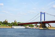 A barge passes under a bridge on the river Rhine near Arnhem, Nederland