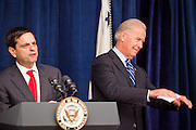 16 NOVEMBER 2009 -- PHOENIX, AZ: Phoenix Mayor Phil Gordon (CQ) LEFT and Vice President Joe Biden at the podium Monday. Biden gestured that people, who stood to greet the VP, should take their seats. Vice President Joe Biden was at Sky Harbor International Airport Monday morning to participate in a round table discussion the Obama administration's economic stimulus program.     Photo by Jack Kurtz