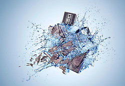 Action shot of a fragrance bottle Burberry Brit Rhythm exploding. Commissioned by Catherine Costello at Men's Health magazine.