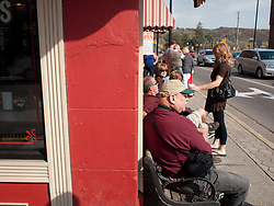 Selections from a day trip to Stillwater,--The Birthplace of Minnesota.  Weary walkers rest at convenient sidewalk benches outside the local malt shop.