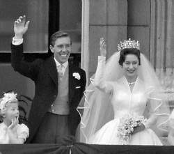 Princess Margaret and Antony Armstrong-Jones wave to the crowds on the balcony of Buckingham Palace after their wedding ceremony at Westminster Abbey in London.