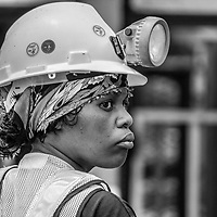 Black and white image portraits of miners in South Africa. Captured moments of their everyday work and just after leaving the elevator bringing them back from the pit after an 8-hour shift.