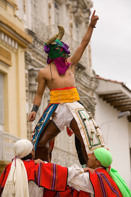 South America, Ecuador, Cuenca.  Human pyramid of dancers in folklore troupe during annual parade and festival to celebrate founding of Cuenca in 1557.  Cuenca is a UNESCO World Heritage Site.