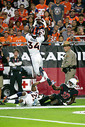 Denver Broncos defensive back Will Parks (34) leaps over Denver Broncos cornerback Bradley Roby (29) and Arizona Cardinals wide receiver Chad Williams (10) as he tries to intercept a pass during the NFL week 7 regular season football game against the Arizona Cardinals on Thursday, Oct. 18, 2018 in Glendale, Ariz. The Broncos won the game 45-10. (©Paul Anthony Spinelli)