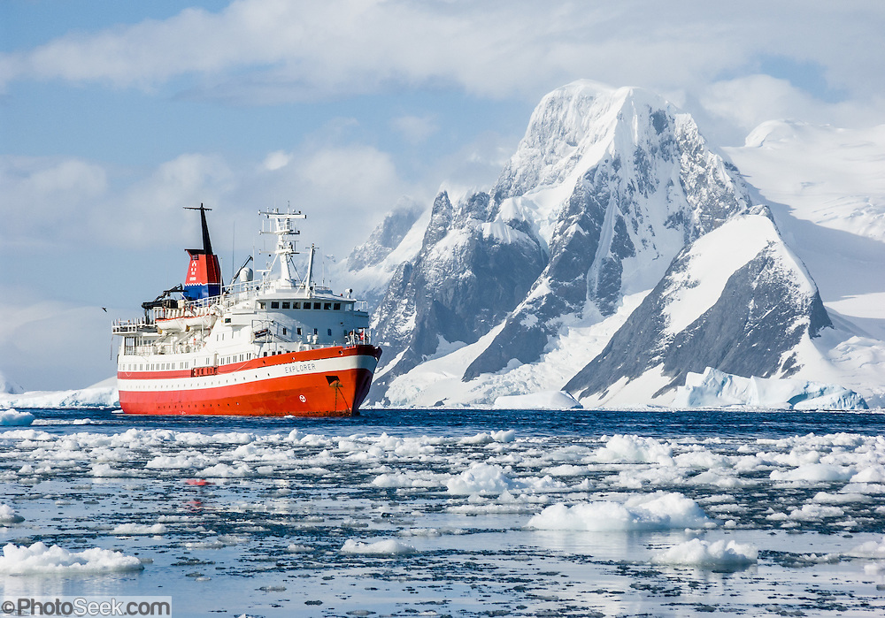 "The M/S Explorer cruises in Antarctica in February 2005. Reuters News Pictures Service published this image in stories on the M/S Explorer, which sank after hitting an iceberg in 2007 and now lies sunk 600 meters deep in the Southern Ocean. Two and a half years after our successful trip, the Explorer, owned by Canadian travel company GAP Adventures, took on water after hitting ice at 12:24 AM EST on Friday November 23, 2007. 154 passengers and crew calmly climbed into lifeboats and drifted some six hours in calm waters. A Norwegian passenger boat rescued and took them to Chile's Antarctic Eduardo Frei base, where they were fed, clothed, checked by a doctor, and later flown to Punta Arenas, Chile. The ship sank hours after the passengers and crew were safely evacuated. Published in ""Light Travel: Photography on the Go"" by Tom Dempsey 2009, 2010."
