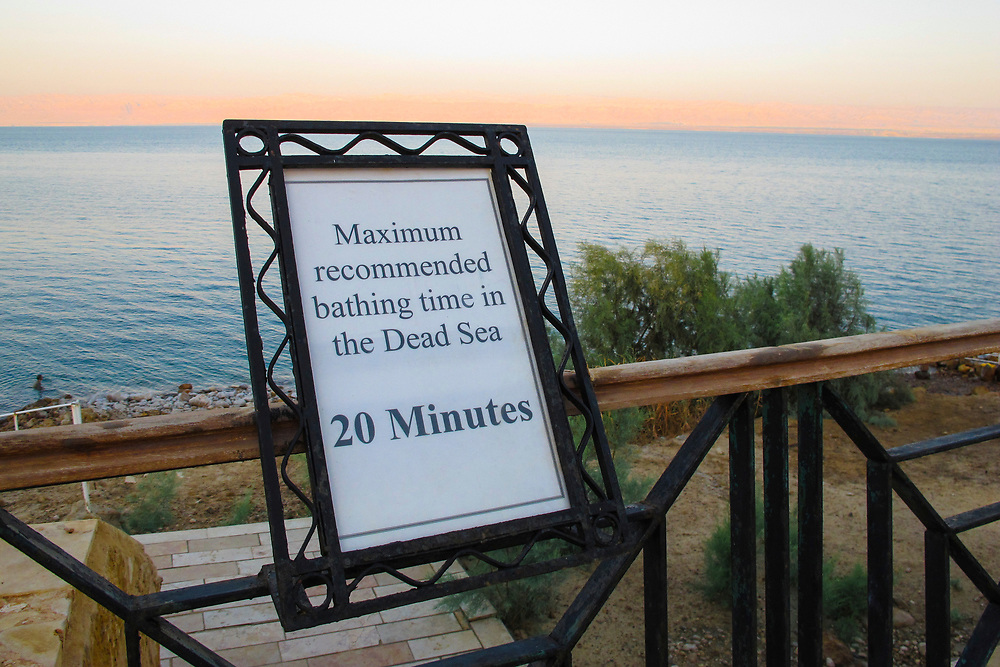 Warning sign at a resort indicating the length of time you can swim safely in the Dead Sea