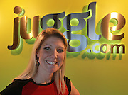 """CrowdSource CEO Stephanie Leffler in front of the """"Juggle.com"""" sign - the corporate owner of the Swansea-based content and SEO business.  CrowdSource recently bought out one of their top competitors, San Francisco-based Servio."""