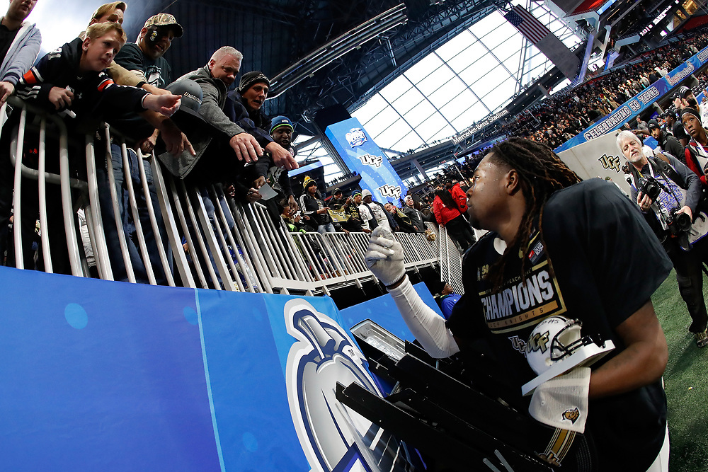 UCF Knights linebacker Shaquem Griffin (18) celebrates beating the Auburn Tigers during the 2018 Chick-fil-A Peach Bowl NCAA football game on Monday, January 1, 2018 in Atlanta. The UCF Knights won 34-27. (Paul Abell / Abell Images for the Chick-fil-A Peach Bowl)