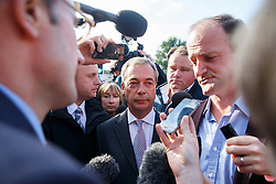 © Licensed to London News Pictures. 10/10/2014. Clacton, UK. Douglas Carswell, newly elected and first ever MP of UKIP for Clacton-on-Sea and UKIP leader Nigel Farage interviewed by a press pack in Clacton town centre on Friday, 10 October, 2014 after their victory in the by-election of Clacton-on-Sea. Photo credit : Tolga Akmen/LNP