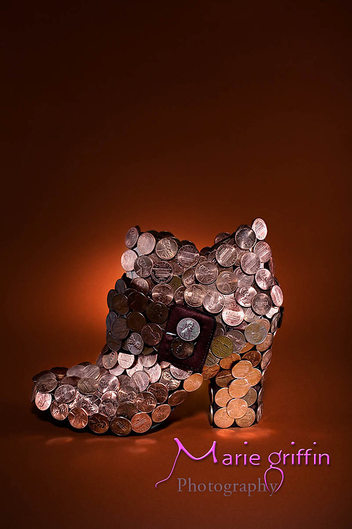 Illustration shoe product covered in pennies for the idea of being stylish on the cheap.<br />Marie G Dennis/Marie Griffin Photography