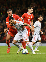 Football - 2018 / 2019 International Friendly - Wales vs. Spain<br /> <br /> Suso of Spain held by Jazz Richards of Wales, at the Principality Stadium (Millennium Stadium).<br /> <br /> COLORSPORT/WINSTON BYNORTH