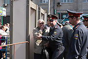 Moscow, Russia, 09/05/2006..Police scuffle with a demonstrator who refused to be searched at metal detectors in Moscow city centre, as Russians celebrated the 61st anniversary of the end of the Second World War, generally referred to in Russia as the Great Patriotic War.