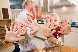 Family showing hands in kitchen