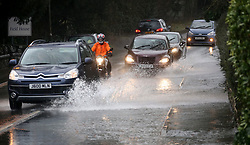 © Licensed to London News Pictures. 06/02/2016cars drive through surface water cause by heavy rain in Shepton Mallet, Somerset. Photo credit: Jason Bryant/LNP