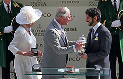 The Duchess of Cornwall and Prince of Wales present a trophy to Sheikh Hamdan bin Mohammed al Maktoum during day one of Royal Ascot at Ascot Racecourse. PRESS ASSOCIATION Photo. Picture date: Tuesday June 20, 2017. See PA story RACING Ascot. Photo credit should read: Jonathan Brady/PA Wire. RESTRICTIONS: Use subject to restrictions. Editorial use only, no commercial or promotional use. No private sales