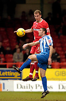 Photo: Leigh Quinnell.<br /> Swindon Town v Chester City. Coca Cola League 2. 24/02/2007. Swindons Andy Nicholas jumps with Chesters Simon Marples.