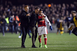 Fans take selfies with Arsenal's Alexis Sanchez on the pitch after the game