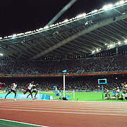 A panoramic view of Justin Gatlin, USA wining the men's 100m final during the Athens 2004 Summer Olympic Games at the Olympic Stadium  Greece. Gatlin won, Francis Obikwelu of Portugal came second and Maurice Greene of USA came third. Athens, Greece, 22nd August 2004. Photo Tim Clayton