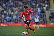 Cardiff City's Kim Bo-Kyung in action during the Barclays Premier league, Cardiff city v Fulham at the Cardiff city Stadium in Cardiff , South Wales on Sat 8th March 2014. pic by Jeff Thomas/Andrew Orchard sports photography