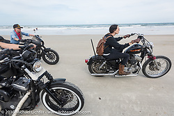 """Kissa Von Addams of the """"Iron Lillies"""" riding out front on Daytona Beach during the Daytona Bike Week 75th Anniversary event. FL, USA. Thursday March 3, 2016.  Photography ©2016 Michael Lichter."""