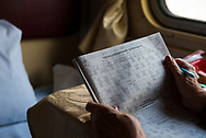 Nearing the end of a 20-hour train journey from Mariupol to Kiev in Ukraine, Antonina sits in her four-berth comparment and works on a crossword puzzle. (September 27, 2015)