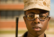 Marine Corps recruit Claytonia Stoddard stands at attention during training at Parris Island, S.C., on Nov. 24, 2007. (Photo by Stacy L. Pearsall)
