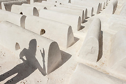 Shadow and white tombs in Jewish cemetery in the old Mellah or Jewish quarter,Fes, Morocco