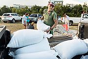 Dale Watson loads sand bags into his truck in preparation for approaching Hurricane Florence September 10, 2018 in Mt Pleasant, South Carolina. Florence, a category 4 storm, is expected to hit the coast between South and North Carolina and could be the strongest storm on record for the East Coast of the United States.