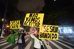 June 9, 2017 - SâO Paulo, São paulo, Brazil - Protesters protest in SP against decision of TSE on Dilma-Temer plate. The group was bantering critics of the minister Gilmar Mendes, president of the court and responsible for the vote of minerva that defined the trial..A group of protesters protested last night (9), on Avenida Paulista, in São Paulo, against the decision of the Superior Electoral Court that rejected the cassation of the Dilma-Temer plate. Demonstrators carried Brazilian flags and banners criticizing Minister Gilmar Mendes, president of the TSE and responsible for the vote of minerva that defined the outcome of the trial. They also defended the Lava Jato operation and praised Judge Sérgio Moro. (Credit Image: © Cris Faga via ZUMA Wire)