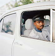Portrait of a driver sitting in Ambassador car, Lucknow, Uttar Pradesh, India